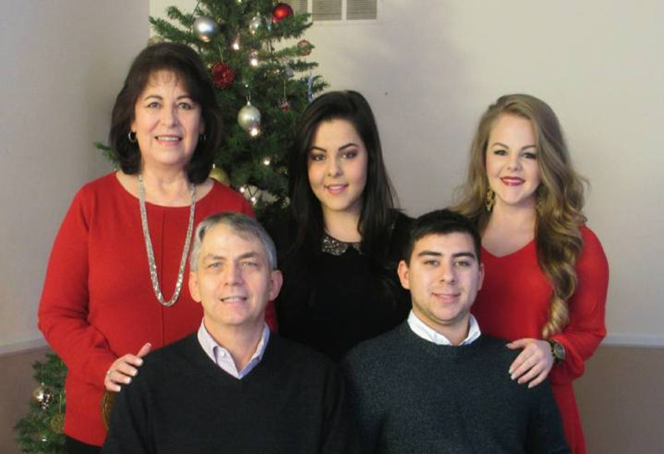 Harlan family at Christmas (Hannah in a red dress on the right).