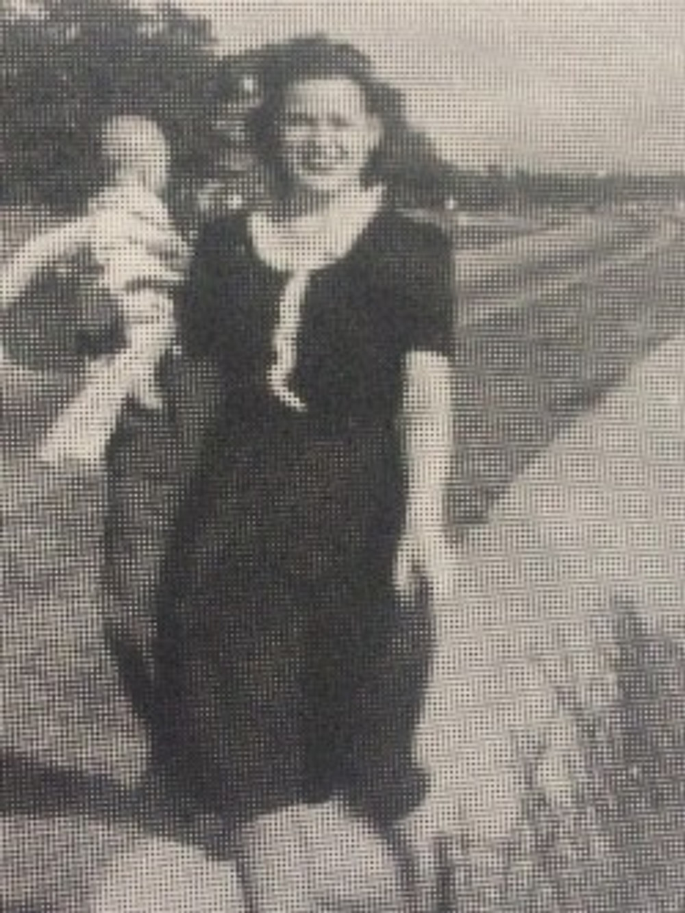 Beulah holding her son Marvin, 1945.