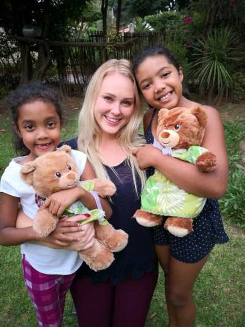 The girls and their counselor with the teddy bears.