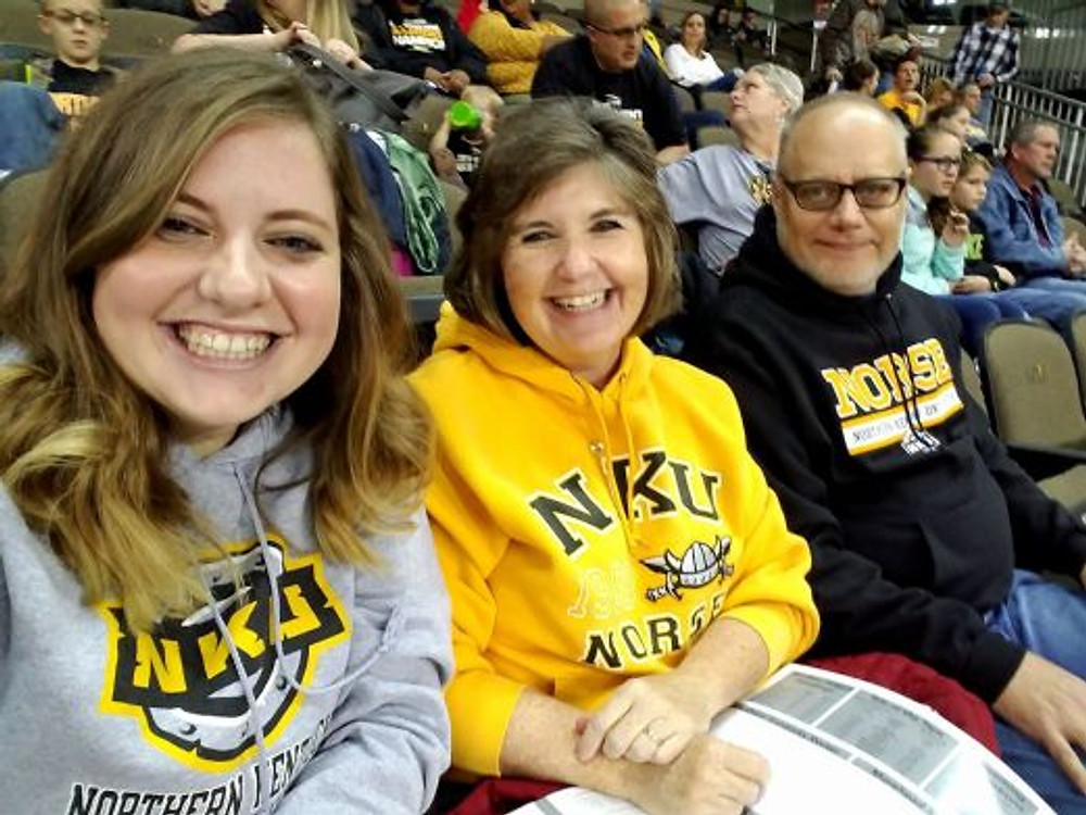 Me (left) with my parents at an Northern Kentucky University basketball game, 2017.