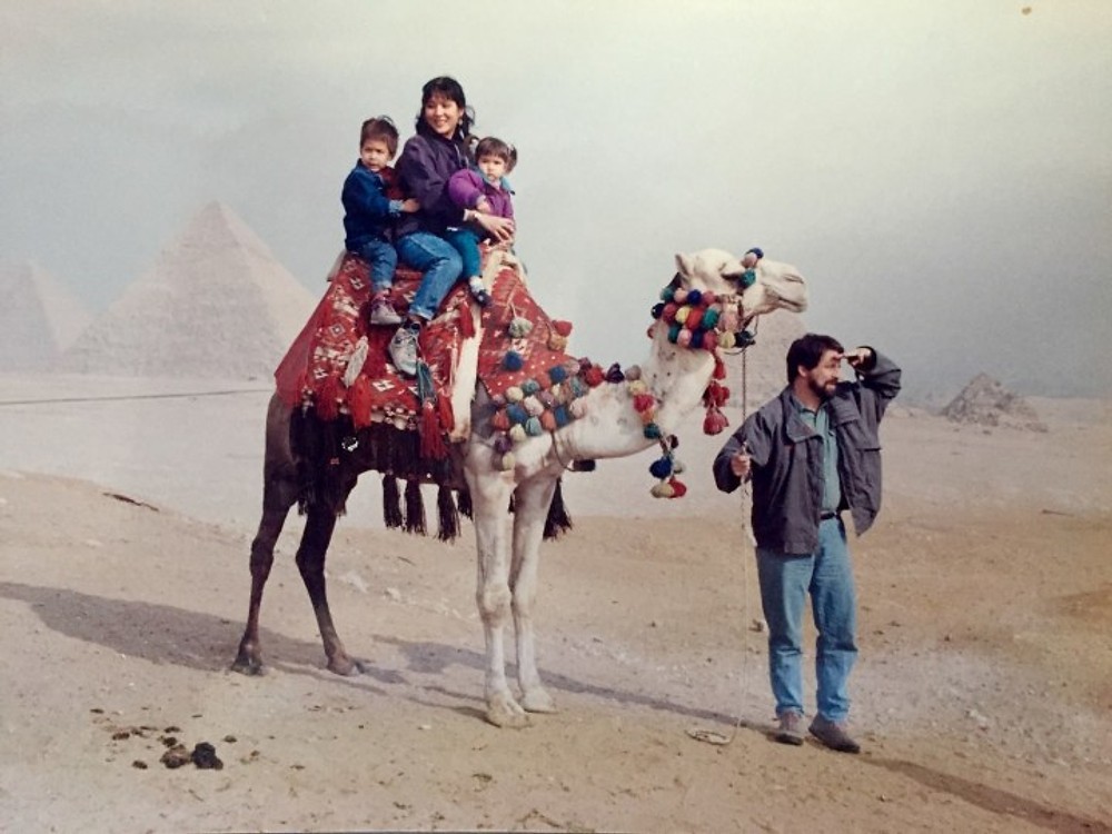 Me at age three, riding a camel in Cairo, Egypt with my family, 1995.