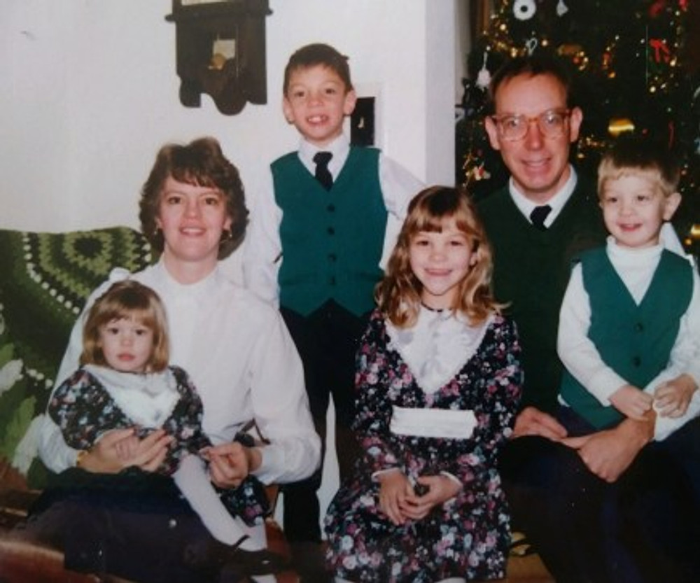 Our old family photo (I'm on the little girl sitting on my mom's lap).