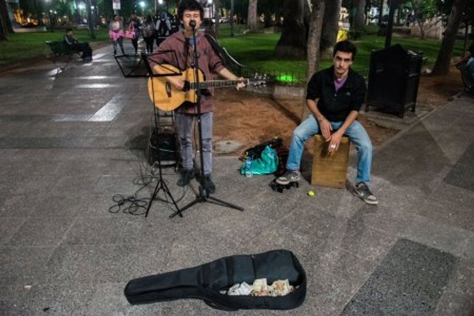 Playing on the streets of Salta, 2016.