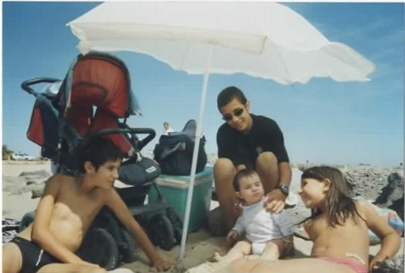 Me (with sunglasses) and my siblings at beach, 2006.