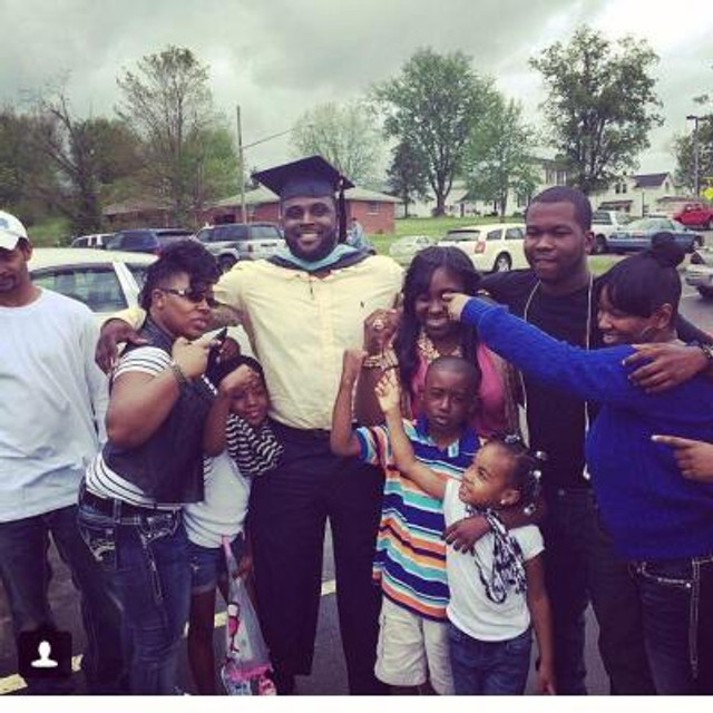 Celebrating my graduate degree with my family, 2014.