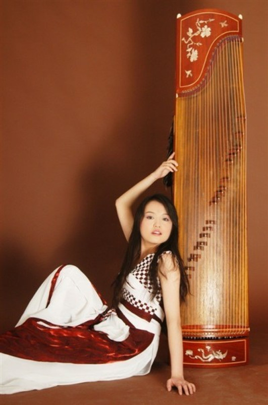 With my guzheng, in my 20s.