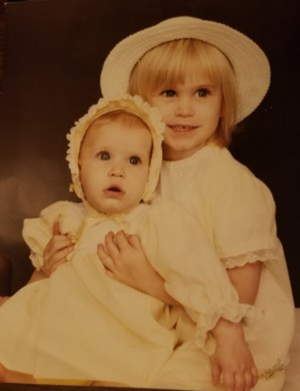 Me, holding my younger sister, 1984.