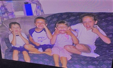 Left to right: Jon (brother), Jake (ex-girlfriend's son), Olivia (sister), and me, 2004.