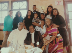 Me (in the black short-sleeved shirt) with my whole family (including Mary in the striped dress).