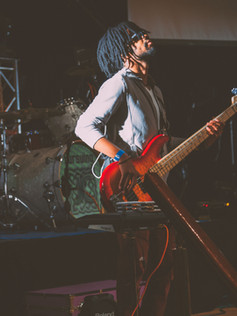 man-standing-while-playing-guitar-158807
