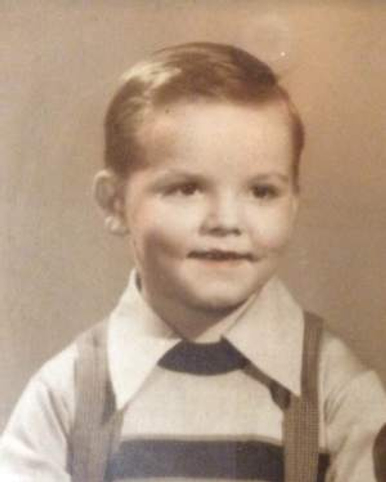 An elementary school photo (don't let the smile deceive you!), c. 1950.