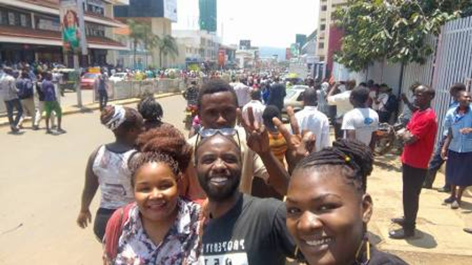 Me (middle in black shirt) hanging out with friends on the Kisumu streets.