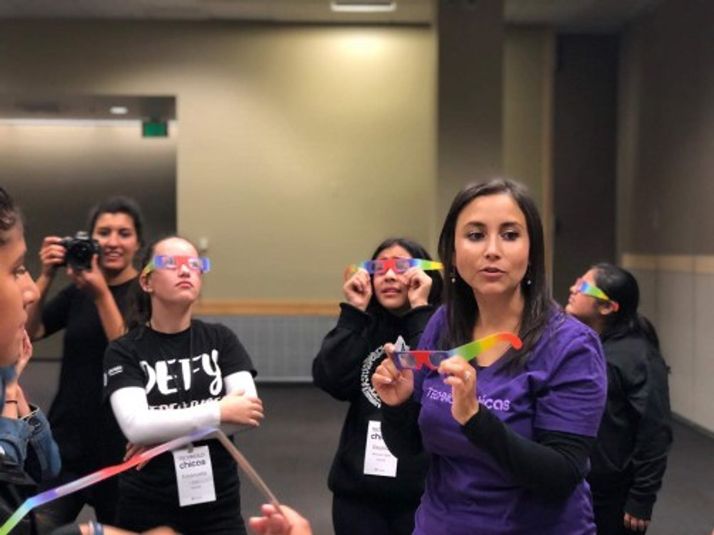 Me during an outreach demonstration with (you know what these are!) diffraction grating glasses.
