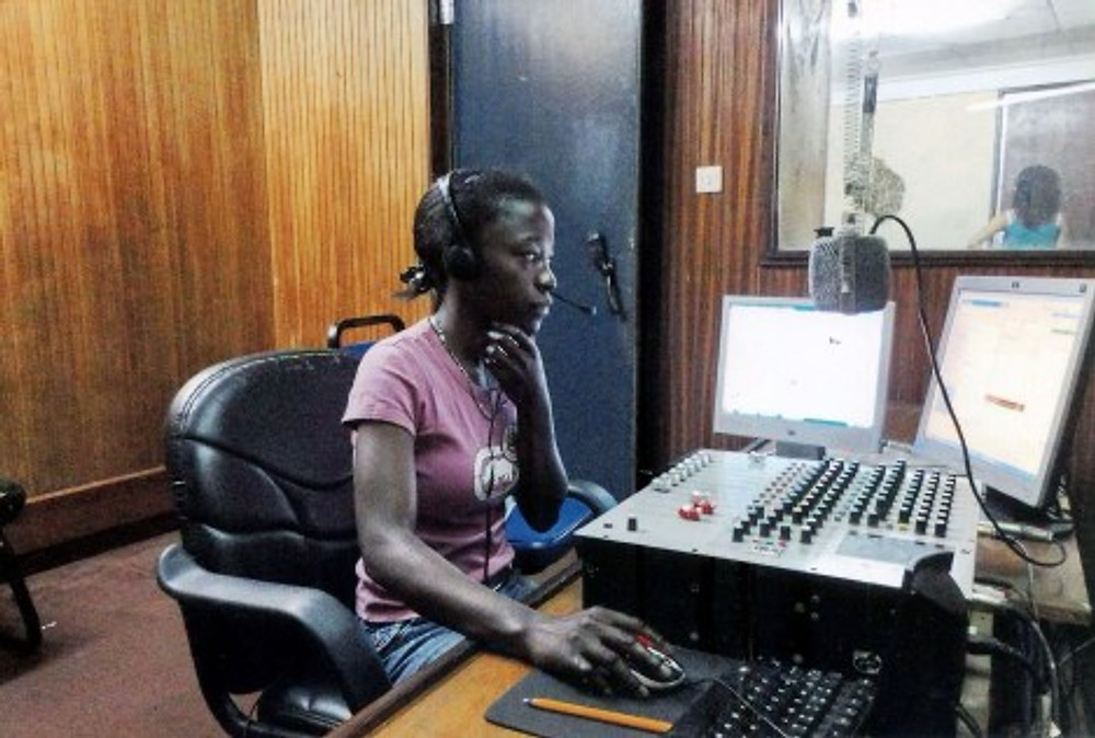 Working at the school radio station, 2010.