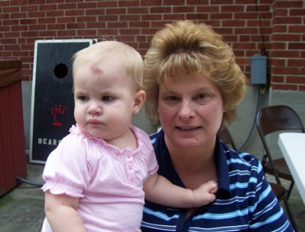 Me holding my niece, 2011.