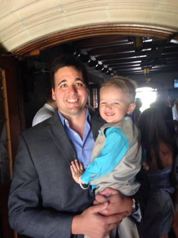 Gerardo holding his son.
