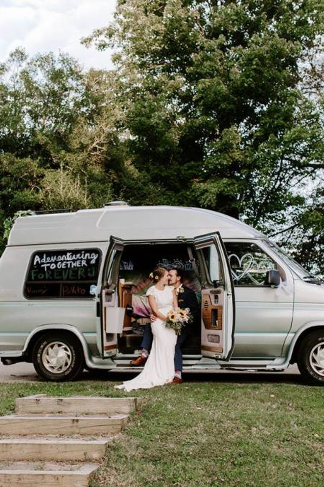 Amelia and Michael on their wedding day, with their van, 2018.