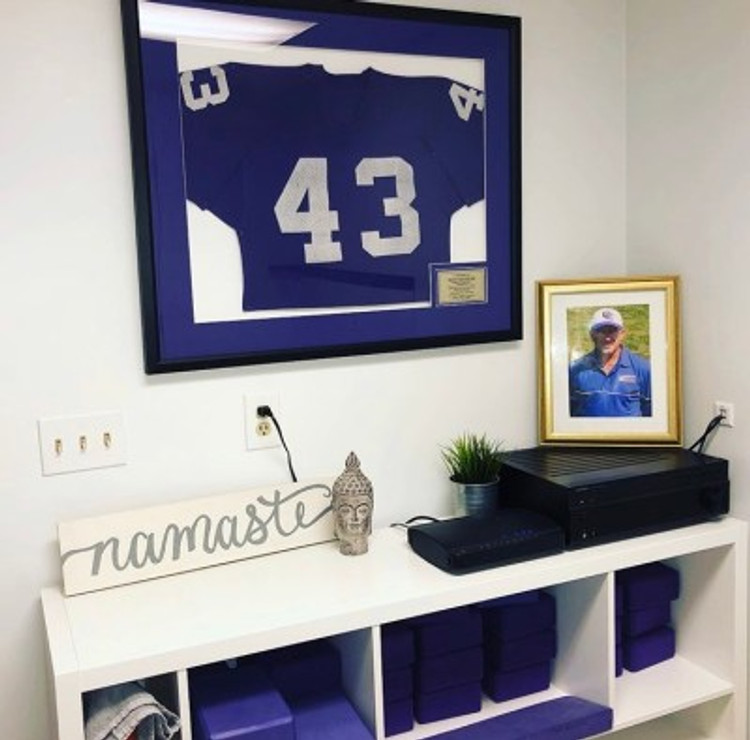 My dad's retired football jersey and photo hang in the studio.