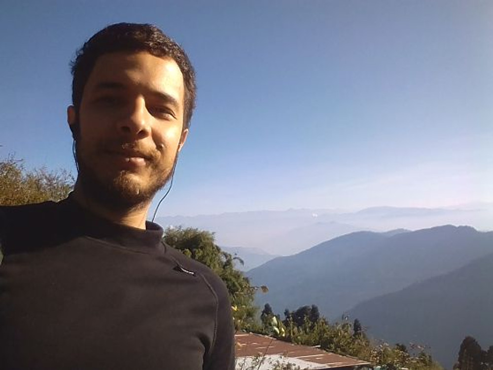 Mehdi Benaouda-at the highest peak above the city of Darjeeling with a view on the Himalayas, December 2017.