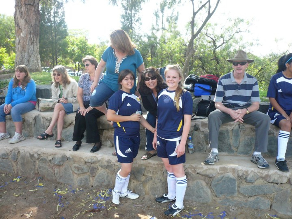 My sister, my mom and me (right) in a soccer game in Bolivia.