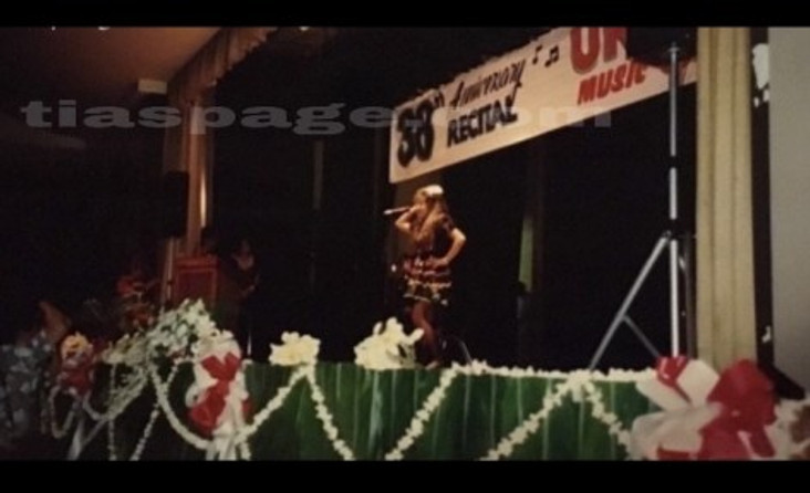 Me performing on stage in Hawaii.