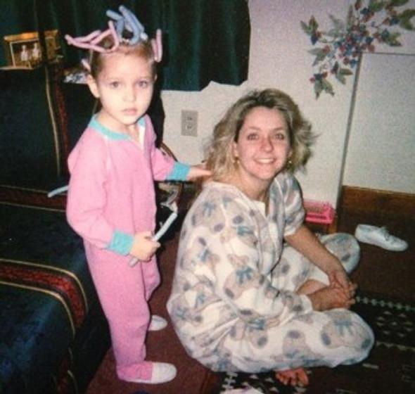 Doing my mom's hair as a little girl.