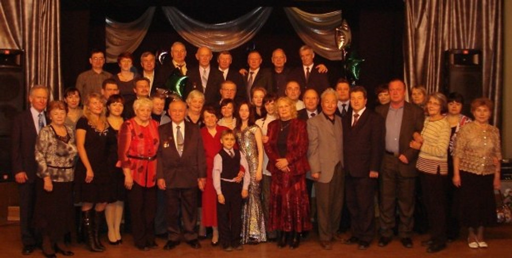 My Grandfather's 80th birthday (the man in black between 2 ladies in red). The medals on his chest are the Order of Friendship of Peoples, Badge of the Honorable Railman and Badge of the Honorable Railman of Mongolia. People around are family and colleagues. I'm the one in a silver dress.