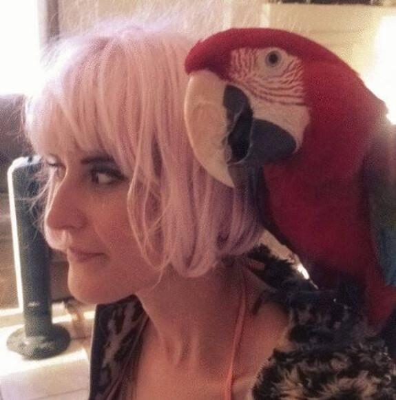 Renee and her macaw, Kingsley.