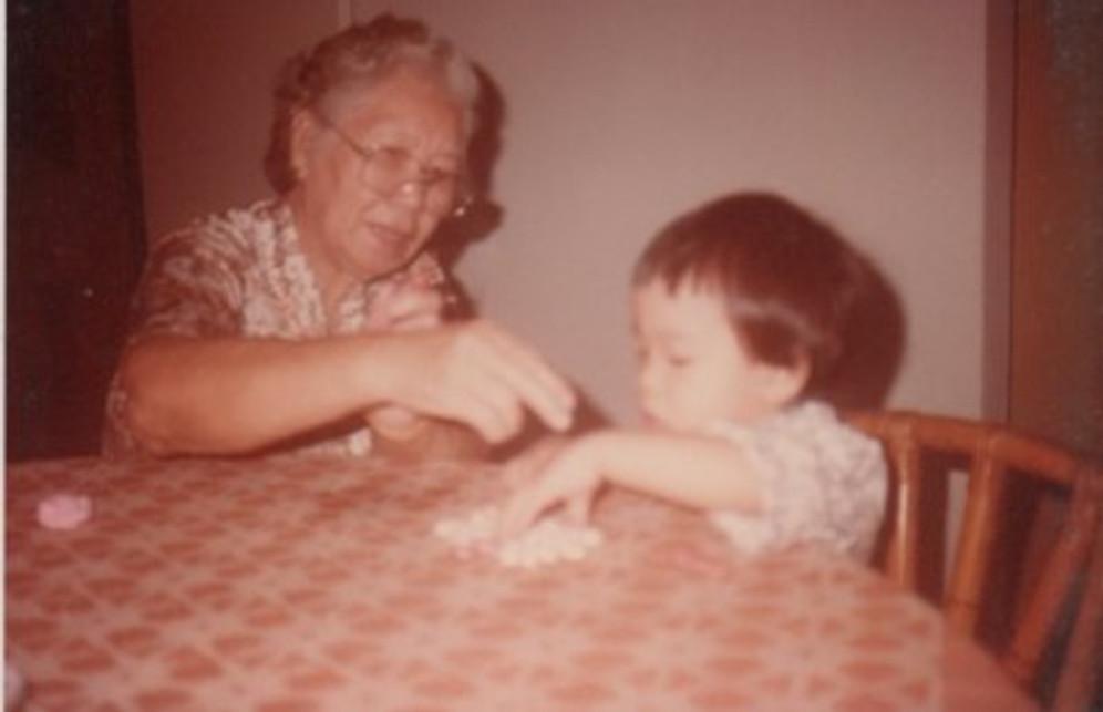Playing with my grandma, age three.
