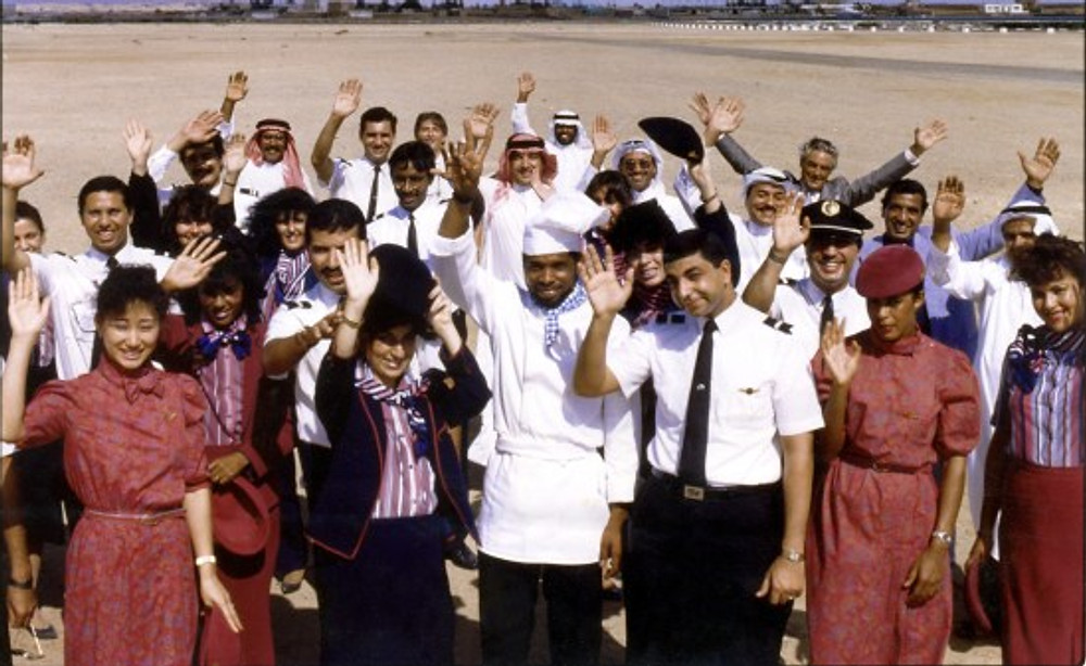 Me (center, with the chef's hat) with the crew of Saudi Airlines, 1987.