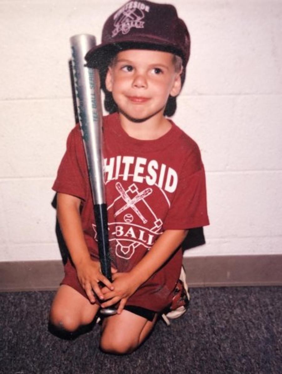 Tiny me in my t-ball uniform, c. 1994.