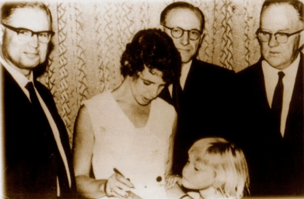 My mother, Ingrid Jonker, receives the APB Prize for Smoke and Ochre, 1963 (I am the little blonde girl at her side).