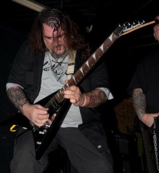 Playing my guitar at one of our shows.