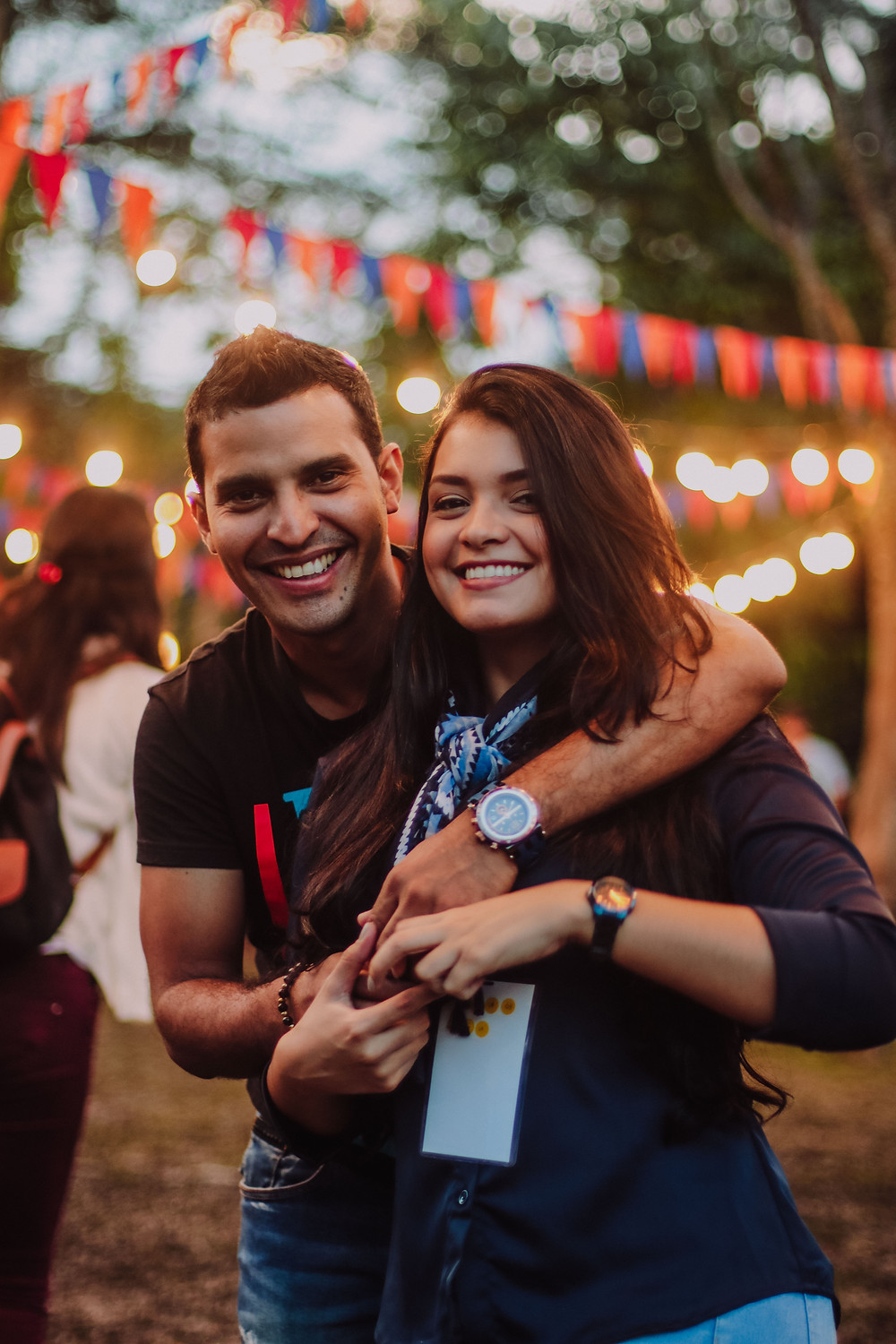 Couple enjoying festival with lights and bunting