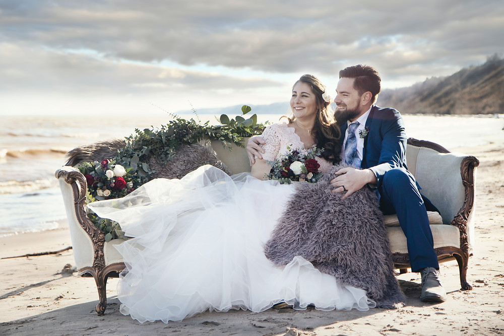 Intimate couple on a chair on a cloudy beach