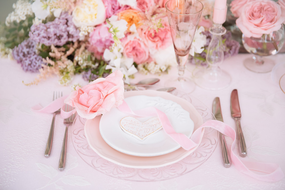 Baby shower table decorations with pink and flowers