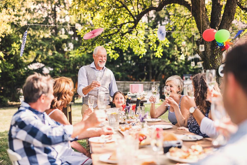 Outdoor wedding celebration toast