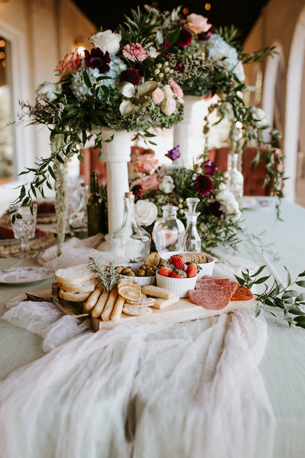 Beautiful grazing board with floral arrangement