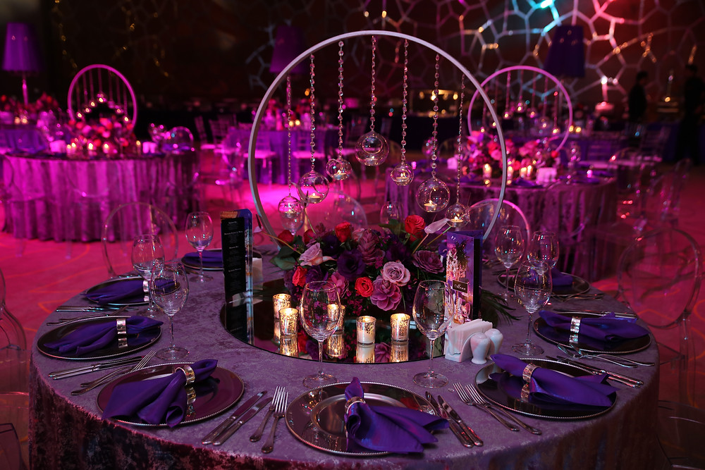 Luxury purple table decor with candles and flowers