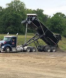 Truck#35 dumping rock_edited.jpg