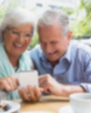 senior-couple-using-mobile-phone-AVTPYE6