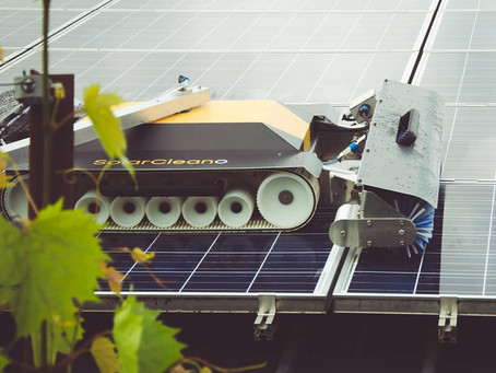 Robot to clean solar panels on cold deck roofs