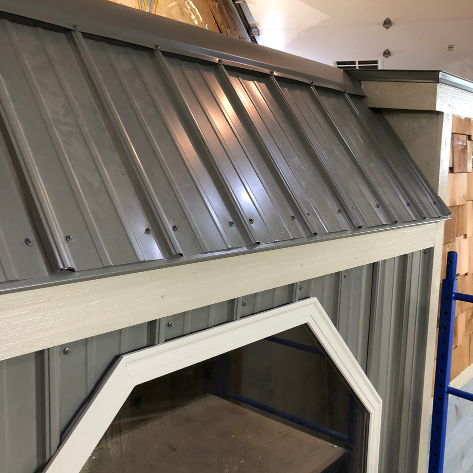 Steel raised seam roofs and accent walls last a lifetime.