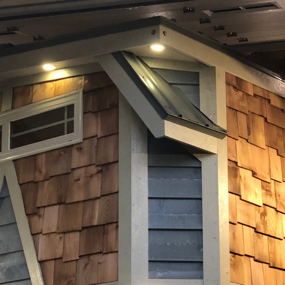 All cedar siding & shake shingles. Exterior LED lighting.