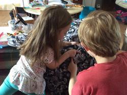 2 STEM kids examining the shirt