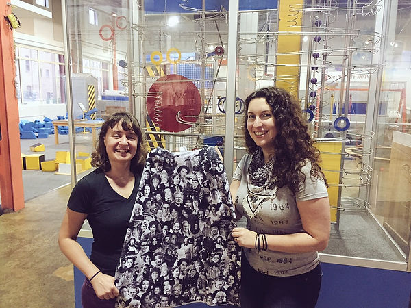 SMLX Good founder Elly Zupko (right) with Emily Landis, making a donation to the Lancaster Science Factory