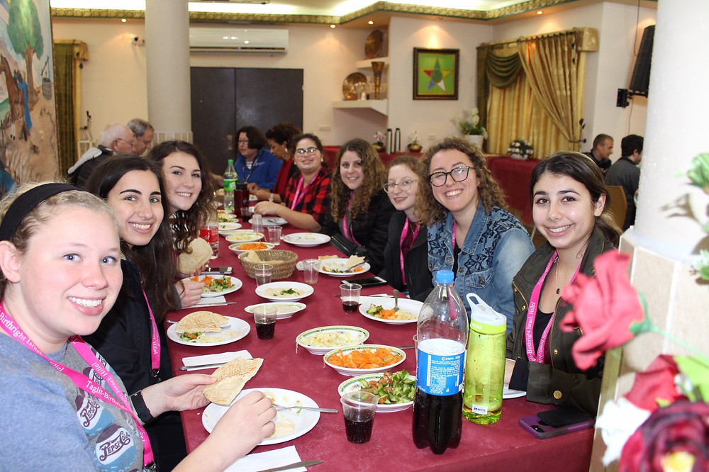 Gillian Zucker and friends enjoying a Druze feast. Photo credit: Casey McKeowen