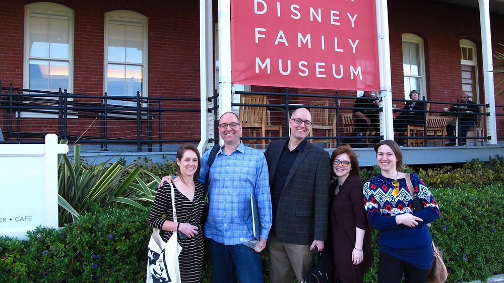 Jenna Calvao, Tony Bancroft, Tom Bancroft, Kota Dimeler and Abby Lee pose in front of the Walt Disney Family Museum.