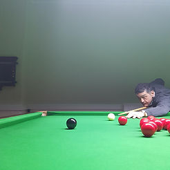A members playing snooker on one of the club's tables