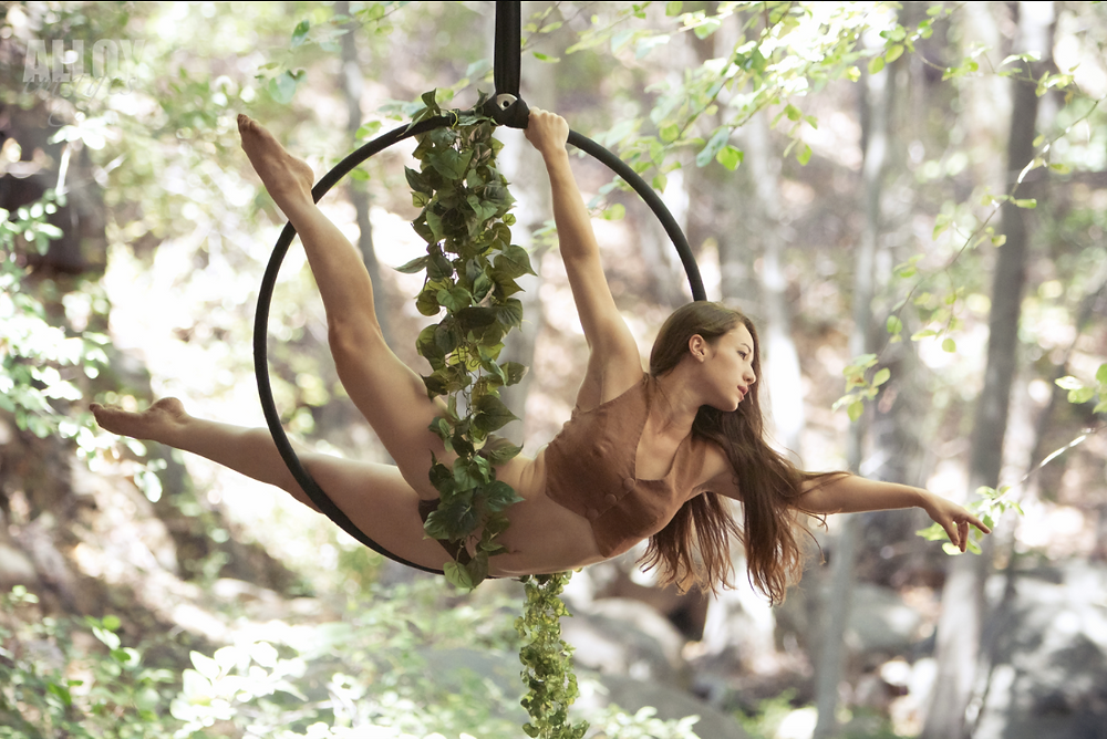 aerialist flying in forest environment